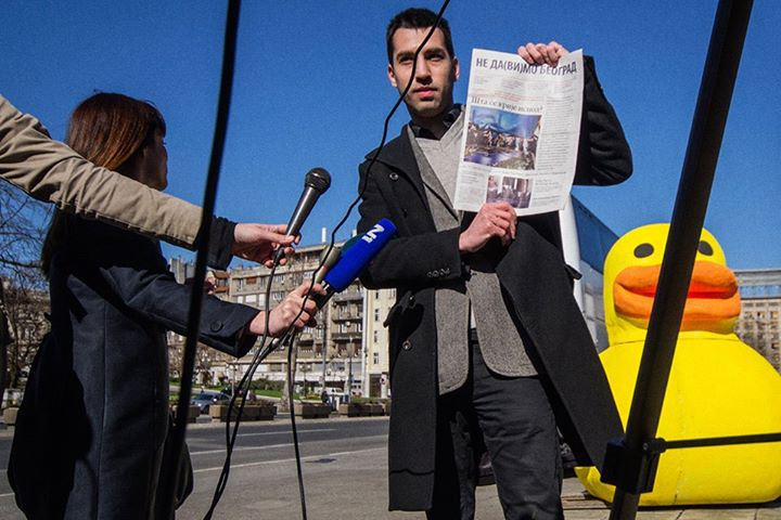 Don't Drown Belgrade's giant yellow duck outside Serbian parliament