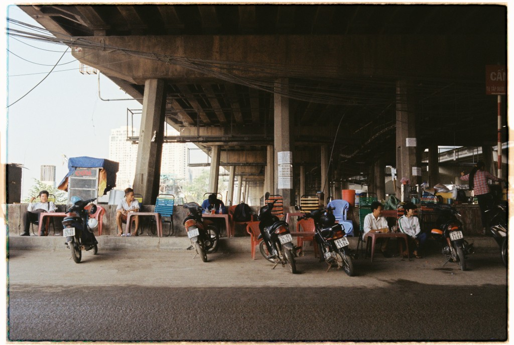 Construction workers take a coffee break under the new underground line running through the city, Dien Bien Phu, Binh Thanh, HCMC