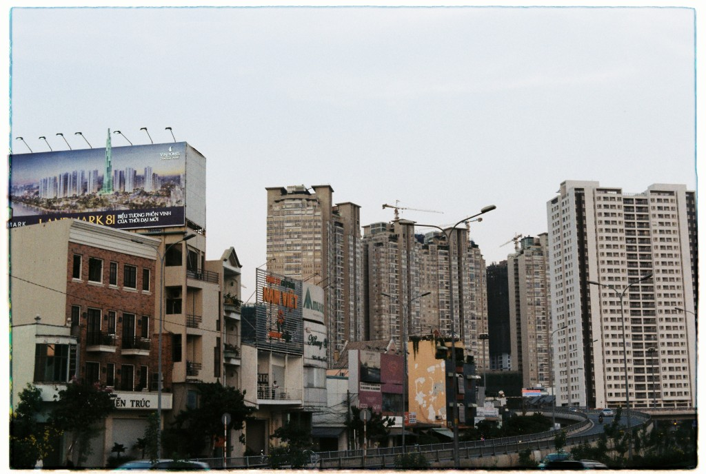 Billboard on Nguyen Huu with Saigon Riverside apartments behind Canh, Binh Thanh District, HCMC